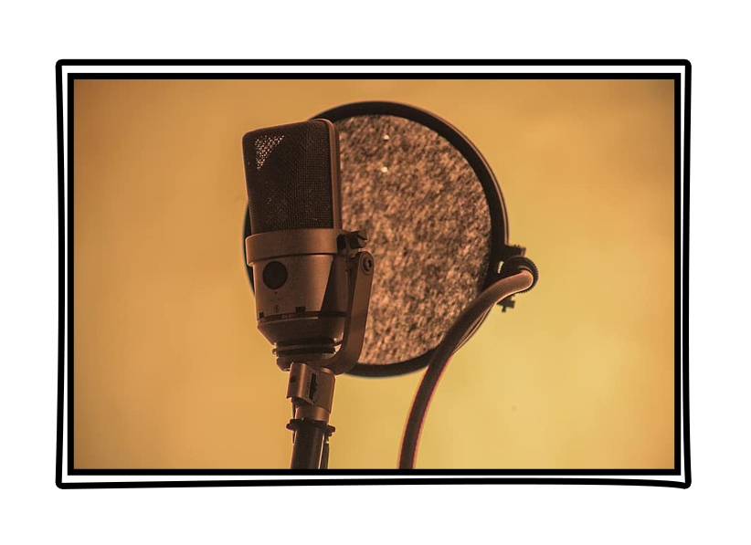 Studio recording microphone and pop shield on yellow background. Framed in comic book style window